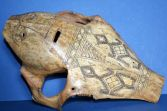 Antique early 20th Century Indonesian scrimshaw cow/bovine bone mask, c1920