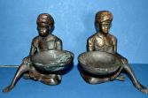 Pair of early 20th Century bronze figural coin bowls, Bergman style, c1920