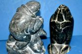 Two antique early 20th Century Inuit carved stone statues, c1920